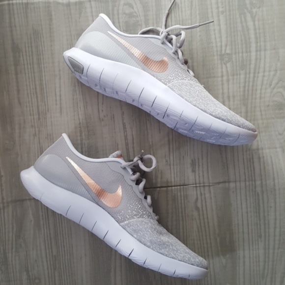 58ed247ba62 Nike Women s Flex Contact Running Shoe Rose Gold. M 5b980512c617773bd9506fcd